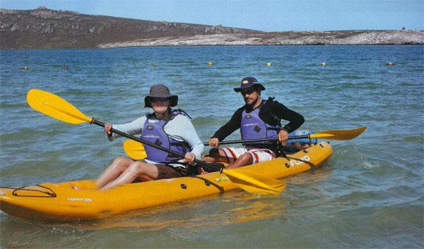 Andrew Kellet of Gravity Adventure Tours and Marianne Heron paddle to the Schaapen Island Bird Sanctuary