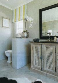The twin vanity from Urban Lifestyle Interior Design kick-started the whole project; it replaced a large corner bath