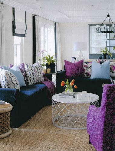 In the living room, Samantha slip-covered the sofas in Linara Navy with contrasting piping in Linara Crocus, the armchairs are upholstered in Heloise Zinnia, and the floral scatters were made up in Botanica Mulberry, all from Romo South Africa. The white coffee table is from Leonardo Design