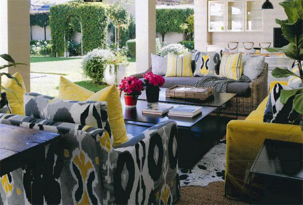 Samantha designed the sofas and the armchairs on the veranda and had them made up in Geneva from Romo South Africa and Designers Guild Espanola Way Charcoal from Home Fabrics. The coffee tables are from Leonardo Design and the white hurricane lanterns from The Private House Co