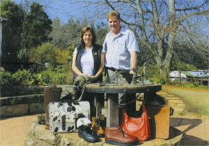Amanda McCarthy and Don Tully of Ground Cover. The bronze Elves and the Shoemaker sculpture and sundial by Abbo Hall are a Meander landmark