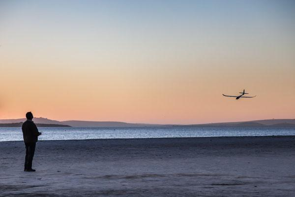 A local flying his radio-controlled plane on the main Langebaan beach. Our beachfront bar waiter said the father and son flying team could be found most evenings, flipping their agile little planes along the wide, sandy beach.