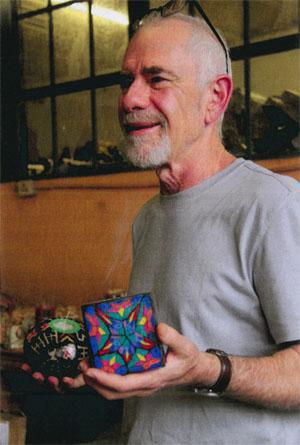 Co-owner of Swazi Candles, Tony Marshak, shows off a new design.