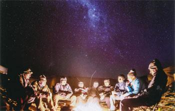 Under African skies, sharing tales of dunes and drifts.