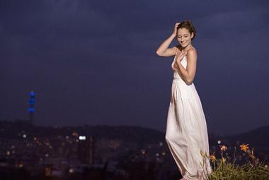 Aimee Thompson posing for a city-fashion shoot at night.