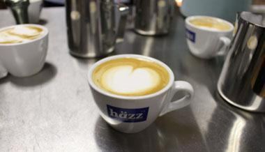 Latte art is the pictures baristas make with the steamed/frothed milk, such as a heart or leaf.
