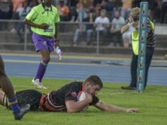 Caption: University of Johannesburg player Driaan Bester crosses for a try in their Varsity Cup Rugby match against Wits in Johannesburg on Monday. Photo: Saspa