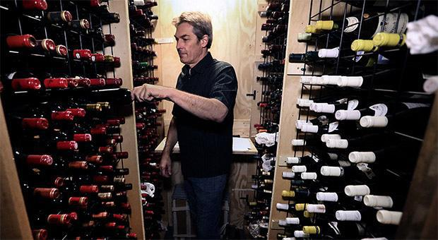 Marc Russell, a Canadian wine collector and founder of The Fine Wine Reserve, stands among some private wooden wine-storage lockers popular in Toronto, due to condo living and the lack of space. (Richard Lautens/Toronto Star via Getty Images) Marc Russell, a Canadian wine collector and founder of The Fine Wine Reserve, stands among some private wooden wine-storage lockers popular in Toronto, due to condo living and the lack of space. (Richard Lautens/Toronto Star via Getty Images)