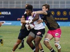 Caption: FNB Madibaz flank Brandon Brown tackles Akhona Nela of NWU-Pukke during their Varsity Cup rugby match at Madibaz Stadium in Port Elizabeth last week. Photo: Asem Engage