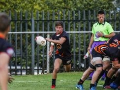 Caption: University of Johannesburg scrumhalf Bradley Thain gets his backline away during a Varsity Cup rugby match. UJ defeated UCT in their final league match on Monday to qualify for the semifinals. Photo: Asem Engage