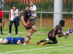 Caption: University of Johannesburg wing Odwa Nkunjana crosses for one of two tries he scored in their Varsity Cup rugby match against Wits in Johannesburg on Monday. Photo: Asem Engage