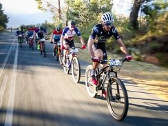 Caption: Matt Beers (front), followed by teammate HB Kruger, leads the men's team race on the 48km second stage of the Liberty Winelands Encounter mountain-bike race in Franschhoek in the Cape Winelands today. Picture: Rat Race Media