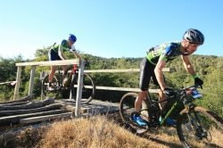 Caption: Shaun-Nick Bester (front) and Andrew Hill negotiate a bridge on the 50km final stage of the three-day PwC Great Zuurberg Trek mountain-bike race, which finished at Zuurberg Mountain Village at Addo, 70km outside Port Elizabeth, today. Picture: Shayne Minott
