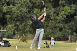 Caption: KPMG Madibaz player Altin van der Merwe, who won the University Sports South Africa individual strokeplay golf title, tees off at the par-three eighth hole during the tournament at Port Shepstone Country Club in KwaZulu-Natal last week. Picture: Karl du Preez