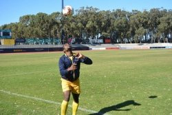 CAPTION: Madibaz captain Cloudious Ray Sagandira warms up for their match against Vaal University of Technology in the University Sport South Africa football tournament at Nelson Mandela University in Port Elizabeth today. Picture: Full Stop Communications
