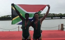 Caption: Mzwandile Sotsaka (left) and Brad Betts, of Rhodes, celebrate their bronze medal in the heavyweight doubles rowing event at the FISU World University Championships in Shanghai, China, this month. Picture: Supplied