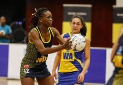 CAPTION: Nobubele Phuza of SPAR Madibaz controls possession against University of Western Cape in the Varsity Netball tournament at the Madibaz Indoor Sports Centre in Port Elizabeth at the weekend. Picture: Michael Sheehan/Varsity Sports