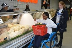 CAPTION: Collegiate Girls' High School Grade 11 pupils Jancke Blume (helper) and Mbali Titi (in a wheelchair) took part in the SPAR Wheelchair Wednesday campaign, which started at SPAR Sydenham yesterday. Picture: Full Stop Communications