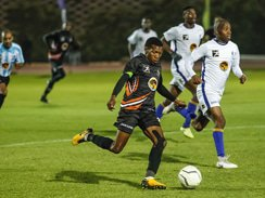 Caption: University of Johannesburg's O'Neil Hendricks (right) and Rorisang Rapelang of Tshwane University of Technology vie for possession during their Varsity Football match at the UJ Soweto Campus in Johannesburg on Thursday. Picture: Denvor de Wee/Visual Buzz SA
