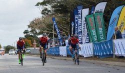 Caption: Alfa Bodyworks-Giant team members Nicol Carstens (left), Rohan du Plooy (middle) and Bernard Esterhuizen cross the finish line of the 106km race in the Bestmed-Makro Cycling Championship in Port Elizabeth today. Du Plooy won the race. Picture: Full Stop Communications