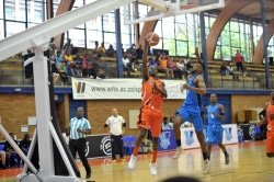 CAPTION: University of Johannesburg's Lance Chikore (left) shoots for goal during their Varsity Basketball match against UCT at the Wits University Sports Hall in Johannesburg last weekend. The defender is Siphumle Qanya. Picture: Craig Nieuwenhuizen/SASPA
