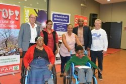 Caption: At the SPAR Eastern Cape Wheelchair Wednesday handover at the Nelson Mandela Stadium in Port Elizabeth yesterday were (back, from left), Spar EC sponsorship and events manager Alan Stapleton, Spar EC sponsorships assistant Debadene Baatjies, Nelson Mandela Bay MMC constituency services Itumeleng Ranyele, Nelson Mandela Bay deputy mayor Thsonono Buyeye, Association for Persons with Physical Disabilities chief executive Brian Bezuidenhout and (front) wheelchair recipients Elizabeth Shadrach and Sitshaba Maqasha. Picture: Full Stop Communications
