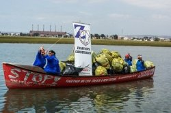 Caption: The SPAR River Paddle Challenge, which generates funds for the Zwartkops Conservancy, takes place in the Swartkops River estuary on November 24. Assisting to clean up the river are Dolly Mitchell (front left), Beronice Komoete (front right), Marie Tierfrei (back left) and Johanna Mitchell (back right). Picture: Full Stop Communications
