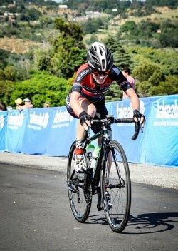 Caption: Carla Oberholzer crosses the line to successfully defend the women's title in the Berge & Dale 108km cycle road race in Krugersdorp on the West Rand today. Photo: Jetline Action Photography