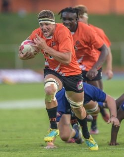 CAPTION: University of Johannesburg captain Adriaan Bester bursts through on his way to scoring a try in their Varsity Cup rugby match against Wits at the UJ Stadium in Johannesburg on Monday. UJ won 39-16. Photo: Christiaan Kotze/SASPA
