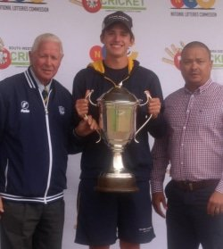 CAPTION: Madibaz captain Travis Ackerman (middle) receives the Petersen Trophy as winners of the South Western Districts premier cricket league from SWD Cricket honorary life president Simon Swigelaar (left) and SWDC president Rudy Claassen. Photo: Supplied