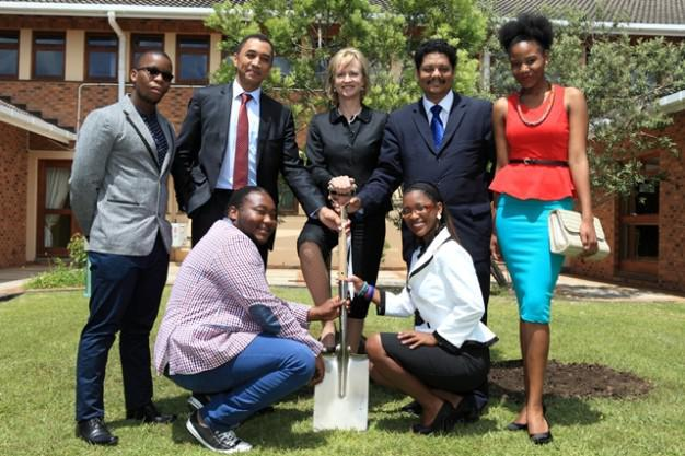 Green and greener…  With respect for the natural environment and sustainable environmental practice key elements of the NMMU value system, it should come as no surprise that a symbolic tree-planting, featuring an indigenous yellowwood tree, was included in Chancellor Botha's visit to the George Campus.  She was assisted by the current generation of students, represented by Student Council members Iviwe Sawuti (standing left) and Asafika Mzinjana (standing right), Anathi Masebeni (front, left) and Samantha Boesak (front, right).  Chancellor Botha is flanked by Prof Derrick Swartz (left), the NMMU Vice-Chancellor and Prof Quinton Johnson, Campus Principal.