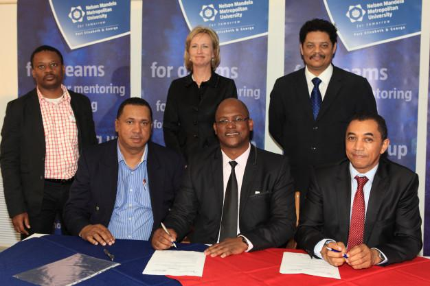 MoU seals closer co-operation between NMMU and South Cape College During the annual NMMU Public Lecture held at the university's George Campus, a memorandum of understanding was signed between Nelson Mandela Metropolitan University and South Cape College in terms of which the two institutions will strengthen their collaboration in certain spheres, such as staff development; matters relating to training in Science, Technology, Engineering and Mathematics (STEM), as well as articulation of programmes, in terms of which SCC students in certain subject areas may gain access to certain programmes offered by NMMU. Signatories to this agreement were (standing) Mr W Mahlangu, South Cape College Councillor, NMMU Chancellor, Ms Santie Botha;  Prof Quinton Johnson, NMMU George Campus Principal, and (seated) Mr R Smit, South Cape College, Council Chairperson; Mr Luvuyo Ngubelanga, CEO of South Cape College and Prof Derrick Swartz, NMMU Vice-Chancellor.