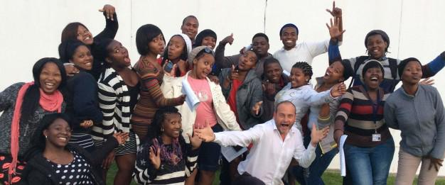 """The NMMU George Campus Choir is hard at work preparing for the upcoming Spring Concert on 6 September.  These members of the 35-person choir joined music maestro, Jan-Erik Swart, to celebrate their first """"official"""" training session with him a few weeks ago.  He expressed his delight at the innate talent of the group."""