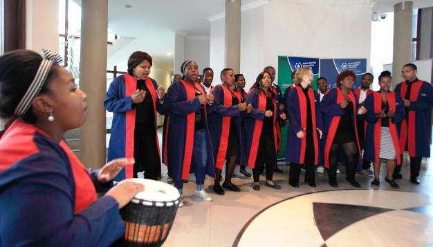 Choir Chairperson, Viwe Bani (left), leading the NMMU George Campus Choir in welcoming guests at a recent on-campus event.