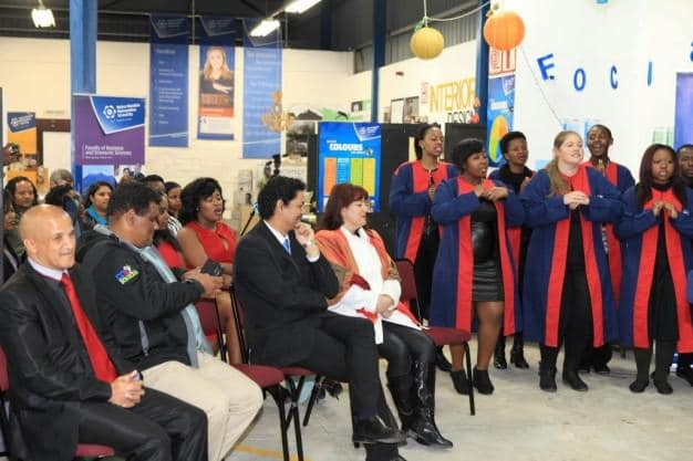 The NMMU George Campus Choir warmly welcomed guest to the opening event of the NMMU George Campus Open Day attended by representatives of the education sector, local government, sport fraternity, media and other stakeholders.  Seated in the front row are – Cllr Daniel Maritz, Deputy Mayor of George; Mr Morne Pietersen, the Eden FM Station Manager; Prof Quinton Johnson, NMMU George Campus Principal, and Dr Bridget Johnson.