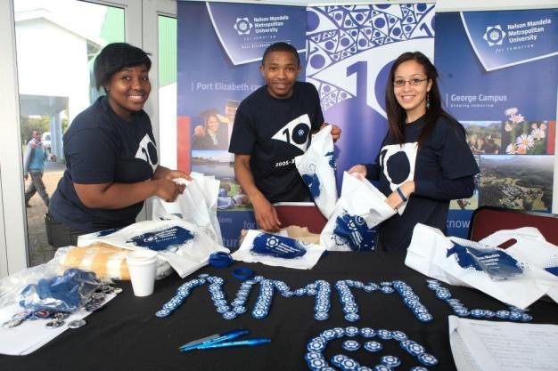Welcoming trio….  Students Viwe Bani, Andile Shume and Alicia Maclean from Marketing and Corporate Relations, George, welcome and assist open day visitors at the registration desk.