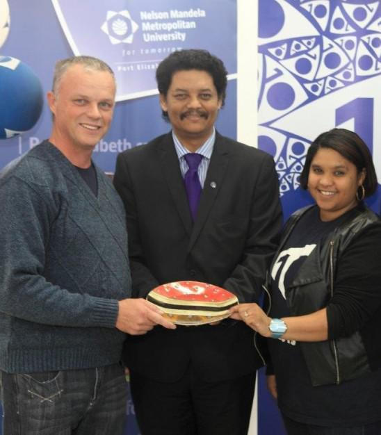 Prof Quinton Johnson, NMMU Campus Principal (centre) congratulated Dr Shaun Gouws (left) who headed up the InnoVenton stall and Ms Sheri-Ann Pietersen from the NMMU Disability Unit – they shared the accolade for Most Interactive Stall at the 2025 NMMU Open Day in George.