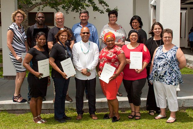 Line Managers joined the Campus Principal and colleagues in congratulating the George Campus long service awardees 2018. Featured here are (back, f.l.t.r.) Dr Adele Potgieter with Dr Takalani Ramukumba (Co-ordinator: Business and Economic Sciences Faculty, George Campus); Dr Anton Schmidt (Director of the School of Natural Resource Management, Science Faculty), Martin Loubser (Director: Operations), Shann Kieswetter (Centre of Teaching and Learning, HEADS), Ilona Joshua, Natalie du Plessis; (front row, f.l.t.r.) Antoinette Piet, Lynette Williams, David Alexander (Campus Principal, Act), Denise Kammies, Natasha Thorne and Elise Labuschagne (Snr Manager: Academic Administration, Act).