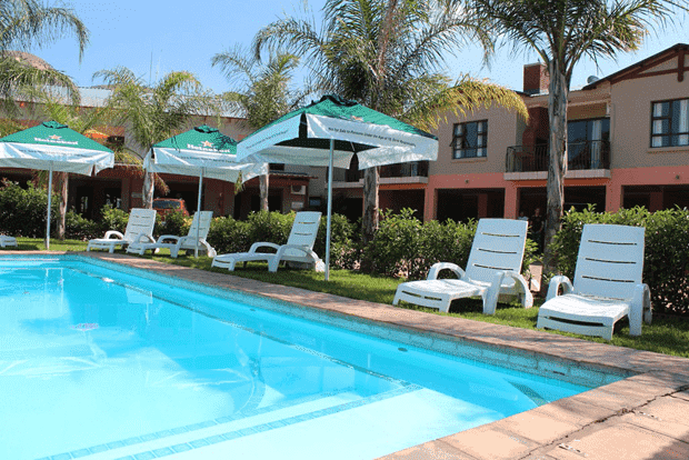 Pool side pub for lazy evening cocktails at Palm Valley Inn in Hartbeespoort
