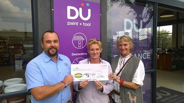 Du Paint, PAWS and Farmers Market Reps handing over the donation