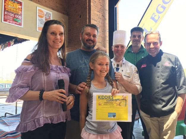 The winner, Lily-Anne Britz , with all the judges.