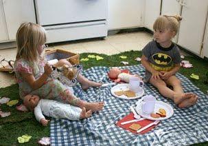 Children having an indoor picnic