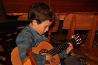 Young Student of TMA playing guitar