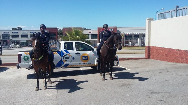 FIDELITY ADT, providing nourishment to Officers and Horses of the SAPS MOUNTED UNIT, together, fighting crime in the Newton park area'