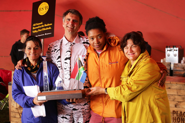 2018 Urban Run Philanthropist, Amanda de Ridder, raised a staggering R15 021 and is pictured receiving her trophy on Sunday from entertainer Gino Fabbri, MBDA representative Asanda Mlata and Cleary Estate Cheshire Home Manager, Hilary Bolton.