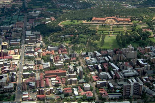 Union Buildings and surrounding city block seen from air.