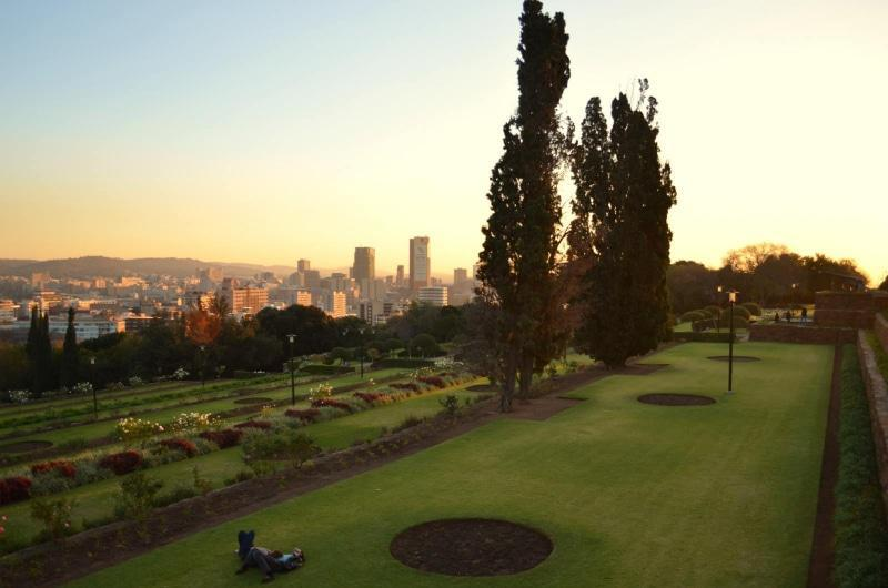 Terraced lawns with view of the city.