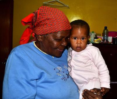 Rhulani's grandmother holding Ziyah, her great-grand child
