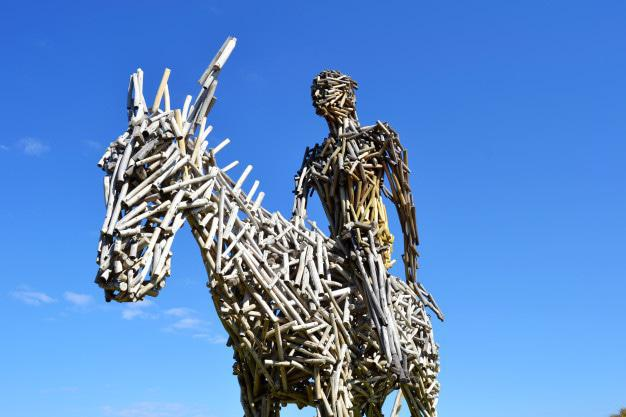 Stick lady on a donkey sculpture by Angus Taylor donated to Hoerskool Waterkloof