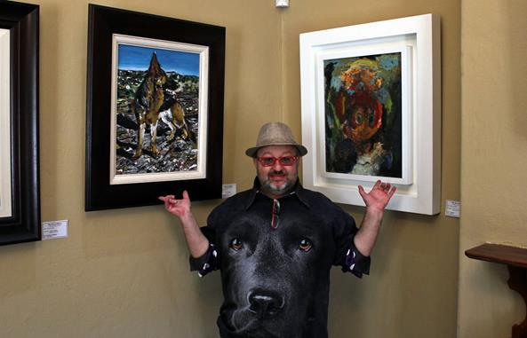 Casper with one of the paintings of his dog and Woody Woodpecker.